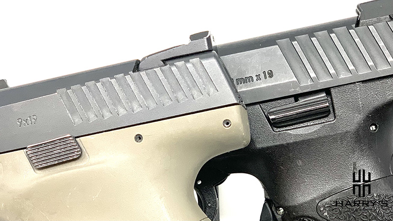 A photo of slide locks on CZ P10c vs HK VP9SK